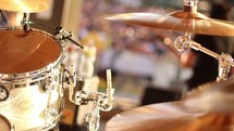 Close-up of a drum set being played.