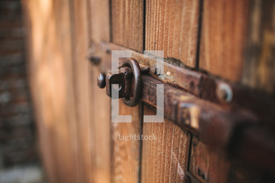 metal latch on a wooded door