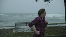 a man running outdoors in the rain
