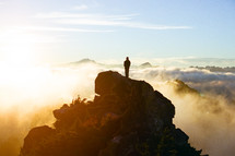 silhouette standing on a mountain peak