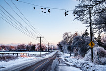 Country road with Shoes on a line after an ice storm in Winter