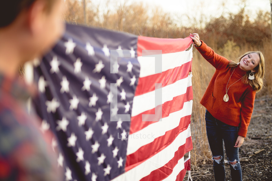 couple holding an American flag