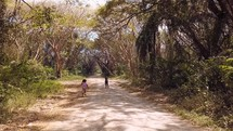 children on a dirt road