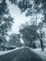 Driving on a Road with Winter Falling Snow