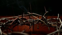 smoke from incense and a crown of thorns
