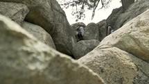 people climbing over rocks