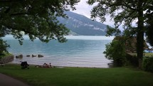 family picnic on a lake shore in Switzerland