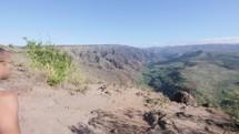 man exploring a mountaintop in Kauai