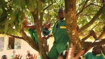 happy school children in a tree