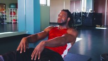 a man doing sit-ups in the gym