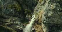 waterfall off the side of a mountain