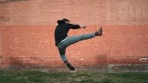 man doing a flying karate kick