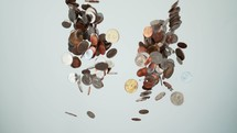 piles of coins being thrown into the air.