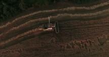 combine plowing a field