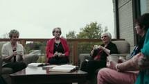 senior women having a Bible study