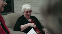 elderly women discussing scripture at a Bible study