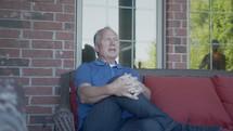 a man sitting on a porch