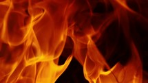 close up of burning flames on black