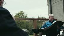 senior men having a Bible study