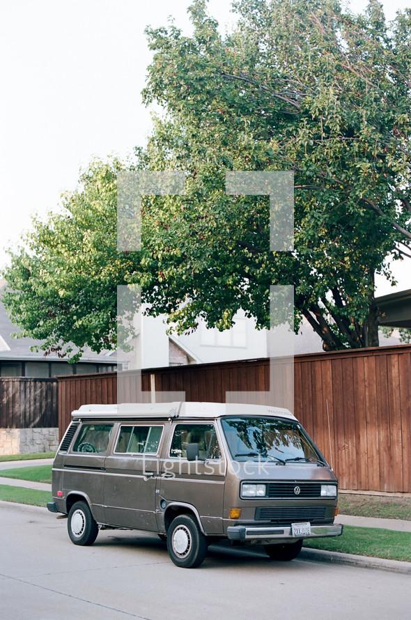 van parked on a neighborhood street