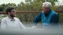 older man mentoring a young man
