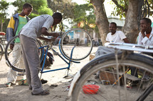 man fixing a bicycle in Ethiopia
