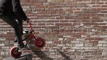 a man riding a stunt bike downtown