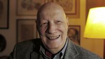 smiling face of an elderly man