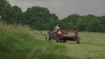 a farmer driving a bailing tractor