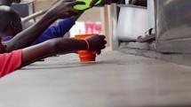 kids getting food in Uganda