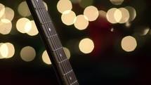 guitar neck and bokeh Christmas lights