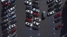 Looking down on a packed parking lot.