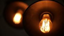 glowing filaments in lightbulbs