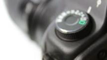 Setting mode dial lock button of the camera reflex - crane shot macro
