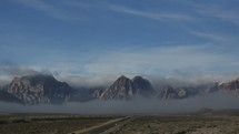time-lapse of fog over a mountain range