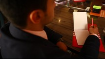 a man in a business suit with a notepad
