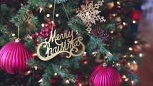 Merry Christmas ornament on a Christmas tree