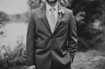 A groom poses for a photo