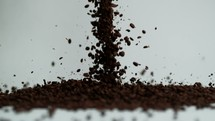 falling coffee beans on white