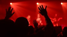 hands lifted during a worship service