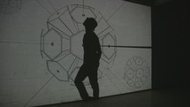 a man dancing in front of a projector