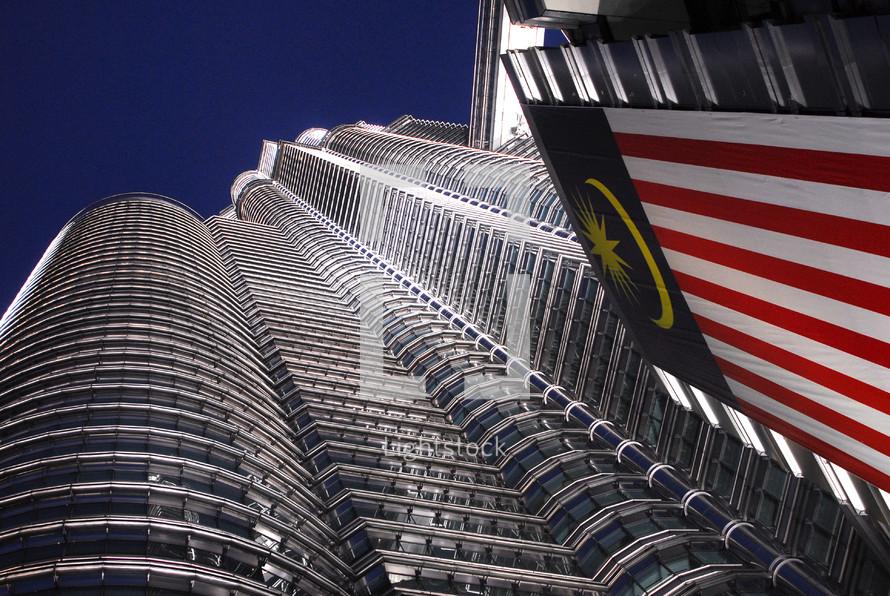 sky scraper and Malaysian flag