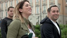 friends walking through Trieste, Italy laughing
