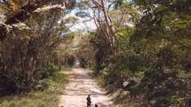 children running on a dirt road