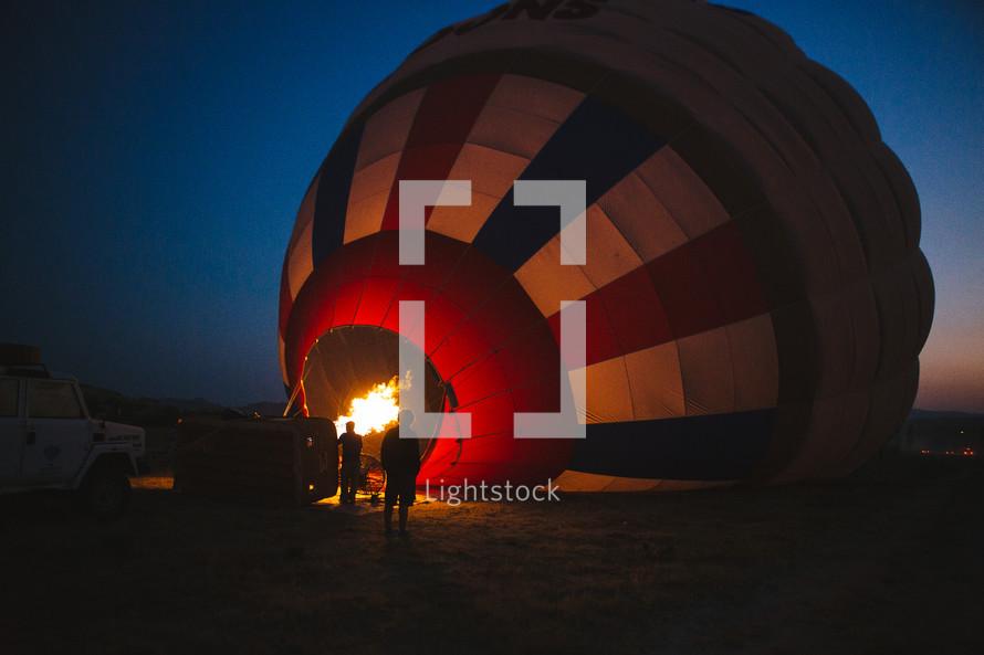 flames igniting a hot air balloon