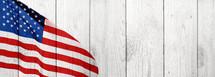 American flag on horizontal wood background