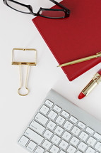red lipstick, reading glasses, computer keyboard, desk, pen, feminine, female, desk