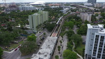 Aerial View of Train Pulling into the Station