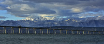 The Hood Canal bridge with the snowy Olympic mountain range in the background.