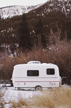 vintage camper in the mountains